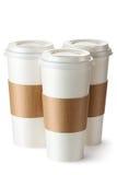 Café para llevar tres con los sostenedores de taza Fotografía de archivo
