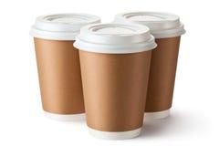 Café para llevar tres en taza terma de la cartulina Imagen de archivo libre de regalías