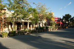 CAFAYATE, ARGENTINA - April 21, 2017:. Restaurants & bars on Avenue General Guemes Sur in proximity to main square park Stock Photos