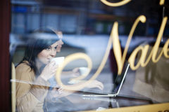 Cafe. Young women in coffee shop Stock Photos