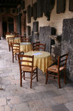 Cafe. Tables and wooden chairs in a historic location royalty free stock images