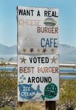 Real cheeseburgers ahead, roadside sign stock images