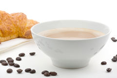 Cafe au lait. With butter croissant over white background Royalty Free Stock Photos