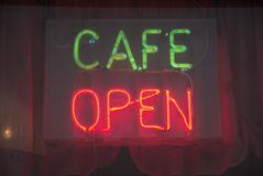 Cafe Bar. Neon illuminated cafe open sign Royalty Free Stock Images