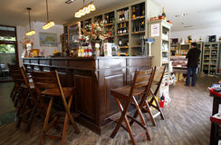 Cafe bar. Wide cafe bar interior with empty bar stools Royalty Free Stock Photos