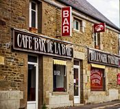 Cafe bar in Cherbourg, France. Cafe bar shop with patisserie in an old building in Cherbourg, France Stock Photos