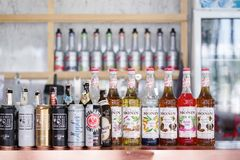 Cafe and bar with selective focus on the row of syrups bottles Monin. royalty free stock images