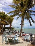 Cafe on the beach with palm trees. Nathon, Koh Samui, Thailand Royalty Free Stock Images