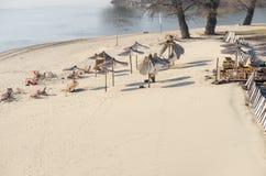 Cafe on the beach. Sunshades parasol on the sandy beach. Royalty Free Stock Photos