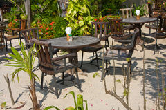 Cafe on the beach , Thailand. Table and chairs in a tropical garden on the shore, Thailand Stock Photo