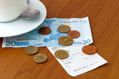 Cafe bill and money Royalty Free Stock Photos
