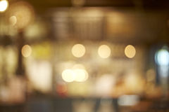 Cafe blur background with bokeh. Blur coffee shop or cafe restaurant with abstract bokeh light image background Stock Photography