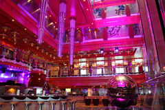 Cafe with bright interior, big chandelier and bar. Cafe with bright multicolored interior,big pink chandelier and bar general view Royalty Free Stock Images