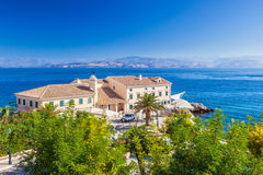 Cafe at building standing on the embankment of Ionian sea Stock Images