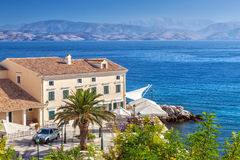 Cafe at building standing on the embankment of Ionian sea Royalty Free Stock Photo