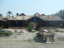 Cafe on Calangute beach. GOA. Colorful rustic dining under a roof of palm leaves Stock Photography