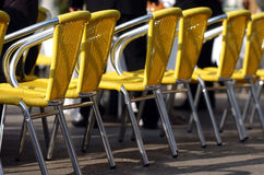 Cafe chairs. Yellow cafe chairs outdoors in a sunny day Stock Image