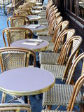 Cafe chairs, Champs-Elysees, Paris. Rows of cafe chairs line the pavement along the Champ-Elysees in Paris stock photo