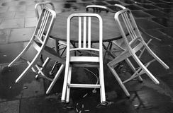 Cafe chairs on a rainy day Royalty Free Stock Photos
