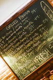 Cafe chalkboard. A traditional cafe chalkboard advertises what's yummy today Stock Photos