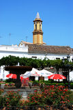 Cafe and church tower, Estepona. Stock Images
