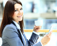 Cafe city lifestyle woman on phone drinking coffee texting text Royalty Free Stock Photo