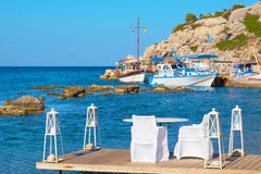 Cafe on a coast. Kolymbia. Rhodes, Greece Royalty Free Stock Photos