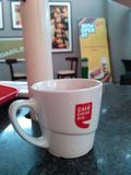 Cafe Coffee day. A Cold day filled with hot Cappuccino Stock Images