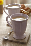 Cafe Coffee Latte in mugs Stock Images