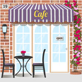 Cafe or coffee shop. Cafe building facade of red brick. Table and chairs at the fore.   Climbing rose near the door. Vector illustration eps 10 Stock Photos