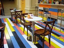 Cafe with colorful wooden floors in the shopping center stock photo