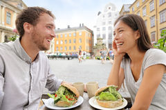 Cafe couple eating food sandwiches in Stockholm Royalty Free Stock Photos