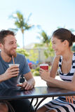 Cafe couple having fun drinking coffee talking Royalty Free Stock Photos