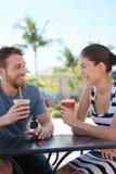 Cafe couple having fun drinking coffee talking royalty free stock photos