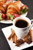 Cafe and croissant with cinamon and anise stars Royalty Free Stock Image