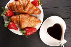 Cafe cup in heart shape and croissant with cinamon and anise sta Stock Photos