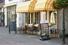 Cafe De Bakkerswinkel on the street of the old city Zoetermeer. Facade of a cafe De Bakkerswinkel on the street of the old city Dorpstraat. 30 August 2018 royalty free stock photos