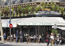 The cafe De Flore, Paris, France. Paris, France-February 27, 2016 : The cafe De Flore is one of the oldest and most prestigious cafe in Paris, located in Saint royalty free stock image