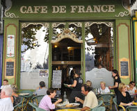 Cafe de France, Isle-sur-Sorgue in France. Isle-sur-Sorgue, France, October 01, 2011: People sitting at the well known cafe de France in Isle-sur-Sorgue.October royalty free stock photos