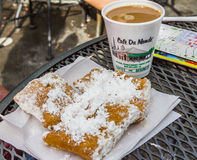 Cafe Du Monde. Famous Cafe Du Monde beingets and chickory coffee in the French Quarter of New Orleans, Louisiana, USA Royalty Free Stock Image
