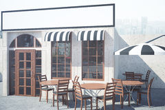 Cafe exterior with empty banner. Stylish cafe exterior with tables, chairs, umbrella and empty banner. Mock up, 3D Rendering Stock Images