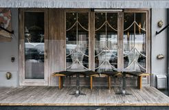 A cafe facade design with stylish elements and furniture. Lot of wooden elements royalty free stock photo