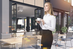 Cafe facade and tables, woman Royalty Free Stock Photography