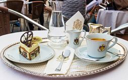 Cafe Florian coffee. VENICE, ITALY - SEPTEMBER 28, 2014:  Dessert, cup of coffee and a carafe of water at Cafe Florian. It  is a coffee house situated in Piazza Stock Image