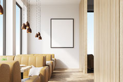 Cafe with framed poster. Cafe interior with wooden elements of decoration, a framed vertical poster hanging on a white wall and beige sofas. 3d rendering. Mock Stock Photo