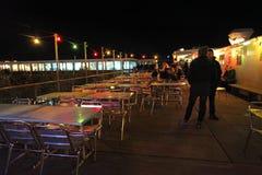 Cafe on Geneva lake by night. Switzerland Royalty Free Stock Photos