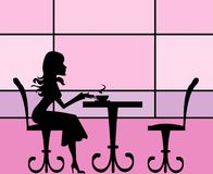 Cafe girl. A silhouette of an elegant girl sitting in a cafe Stock Photo