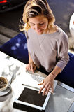 Cafe girl with computer Royalty Free Stock Image