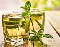 In cafe is glass with mohito green drink and lime. Royalty Free Stock Photo