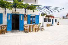 Cafe greek lefkes paros cyclads greece. Outdoor cafe setting with typical greek furniture chairs and generic architecture in the greek islands village of lefkes Stock Photo